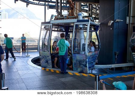 HONG KONG – JULY 15, 2017: Tourists get to cable cars Giant wanting to go to a buddha statue in hong kong