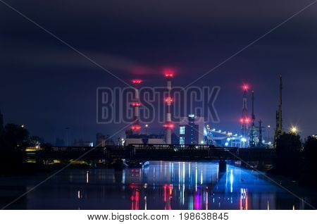 GENERATING STATION - Chimneys and power station buildings at night