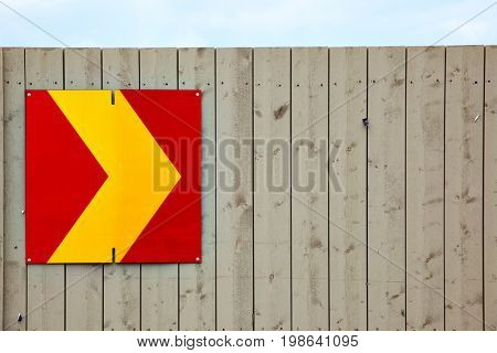 Arrow sign on wooden fence. Copyspace composition