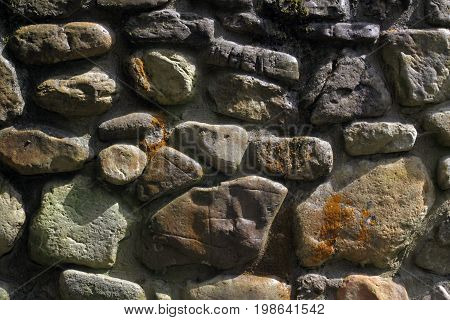 A fragment of a wall of a different size stone