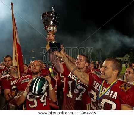 WOLFSBERG, AUSTRIA - AUGUST 22 American Football B-EC: WR Florian Starzengruber (#17, Austria) and his team celebrate the championship on August 22, 2009 in Wolfsberg, Austria.
