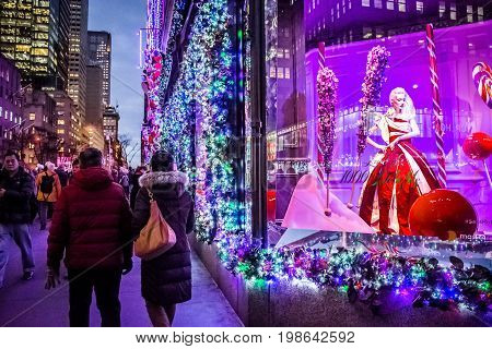 NEW YORK-DECEMBER 7: Tourists and New Yorkers admire the holiday decorations and lights on Saks Fifth Avenue on December 7 2016 in New York City.