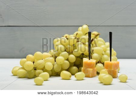 Delicious Appetizer With Cheese And Summer Fruit, Close Up