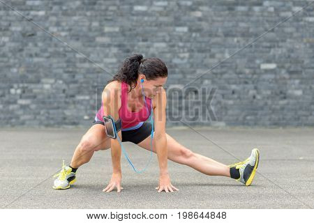 Fit Woman Listening To Music While Exercising