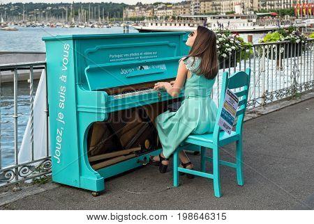 Elegantly Dressed Undefined Girl Play On Piano On Embankment On Geneva Lake