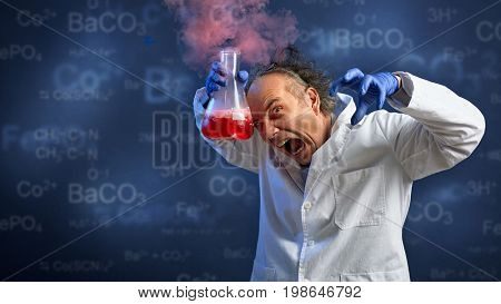 Mad chemist yelling and holding very with toxic chemicals in tube