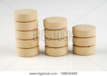 Yellow pills pile,pills pack, medical therapy, isolated
