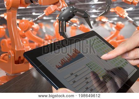 Man Is Controlling Robotic Arms With Tablet. Automation And Indu