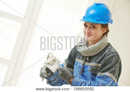 Plasterer Portrait at indoor wall work