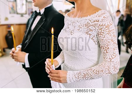 Unrecognizable Bride And Groom In The Church During The Christian Wedding Ceremony. Close-up