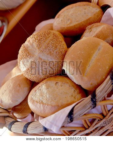 Beautiful composition with bread and buns in wicker baskets
