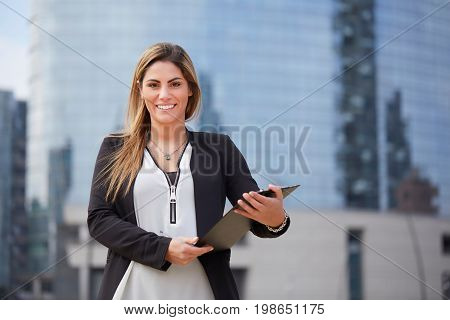 portrait of a professional business woman smiling outdoor