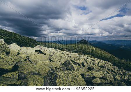Carpathian mountains summer landscape with dramatic sky and rocks. Gorgany range, Ukraine
