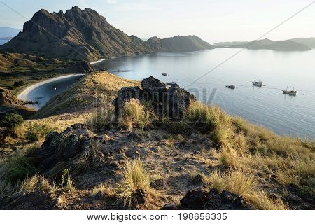 Padar Island With Scenic High View Of Boats And Beautiful White Sandy Beaches Surrounded By A Wide O
