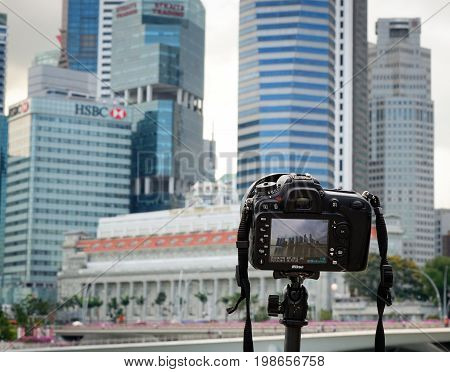 Dslr Camera With Cityscape Background