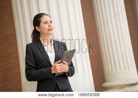 Female Lawyer Holding Digital Tablet Computer