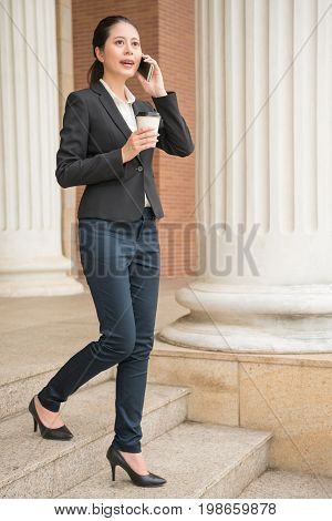 Lawyer Using Her Mobile Smartphone To Discuss