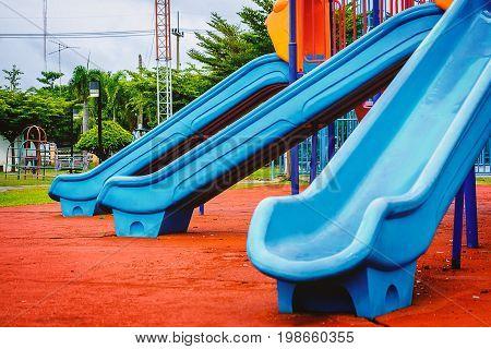 Blue plastic playground slider for kids or children