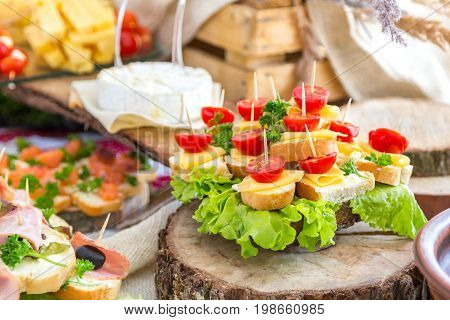 Tomatoes and cheese. Banquet feasts. Banquet table