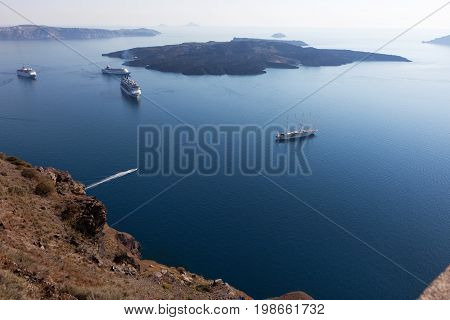 Cruise liners near the island of Santorini. View of the caldera