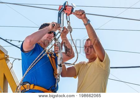 Ukraine Migea - July 30 2017: Zipline. The instructor conducts the instruction on safety of the next fan of an extreme. Starting platform on a high rock. Extreme and active rest.