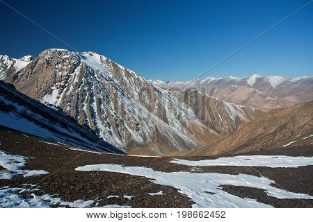 View from mountain pass on the rocks and peaks in Tien-Shan Kyrgyzstan