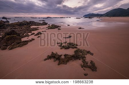 Morning Low tide. Sunrise sand beach near the Noja town, Cantabria, Northern Spa