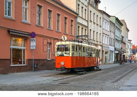 BYDGOSZCZ, POLAND - AUGUST 1, 2017: Architecture of Bydgoszcz city with old tram used as tourist information in Poland. Bydgoszcz is the city with beautiful neo-gothic and neo-baroque architecture.