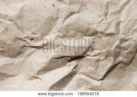 Wrinkled brown kraft paper textured background used as design element or decoration