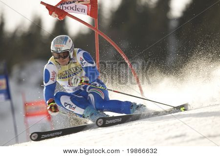 ADELBODEN SWITZERLAND JANUARY 06, Italy's ski racer Peter Fill attacks a gate while Competing in the Audi FIS Alpine Ski World Cup Event in Adelboden, Switzerland, 06/01/2008
