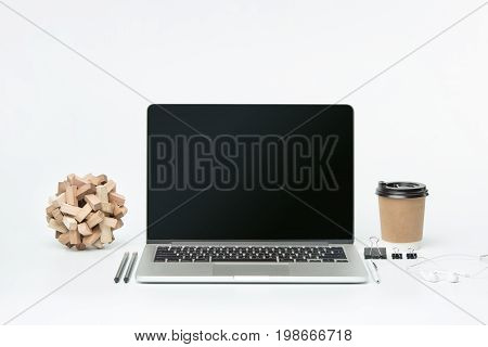The front view of notebook and cup of coffee. Inspiration and mock-up concept, workspace or coffee break in the morning