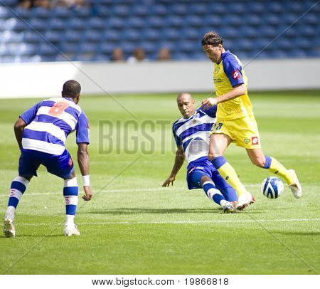 LONDON, UK AUGUST 2, Fitz Hall tackles Erjon Bogdani at the pre-season friendly football match between QPR and Chievo,