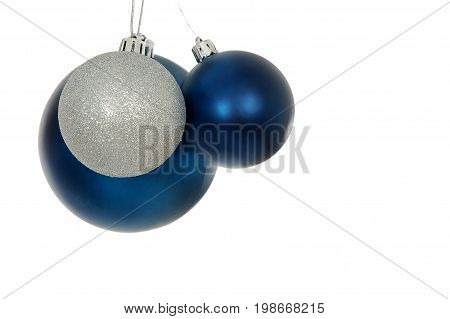 Simple and traditional bright and colorful Christmas balls on white.