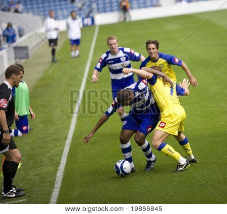 LONDON, UK AUGUST 2, Hall and Marcolini tussle for the ball at the pre-season friendly football match between QPR and Chievo,