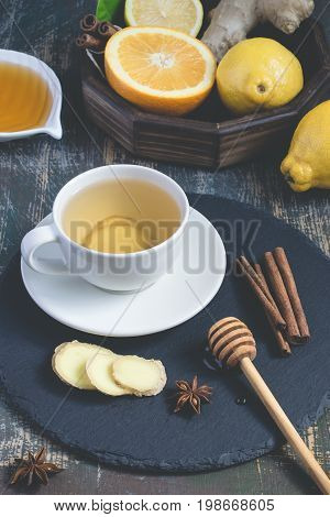 Ginger hot immunity boosting Vitamin natural drink With citrus honey and cinnamon and ingredients.