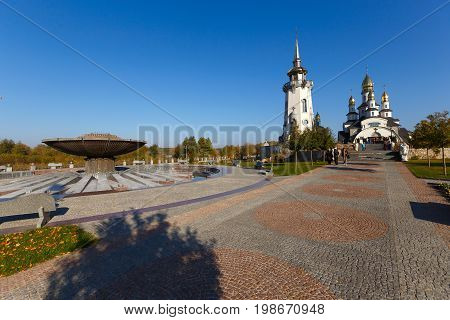 Bell tower in the temple complex built in a modern style in the village of Buki Ukraine. October 11 2014