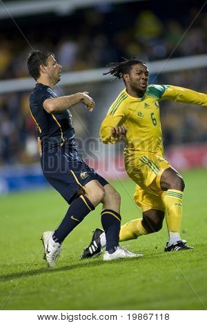LONDON, UK AUGUST 19,Macbeth Sibaya and Mile Sterjovski  playing in the international football friendly match between Australia and South Africa held at Loftus Road London 19/08/2008