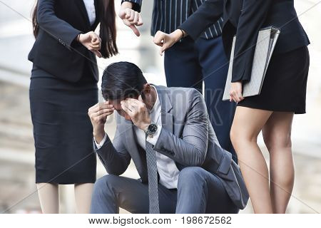 Business man holding his head in hands. Stress Mistake Depression concepts.