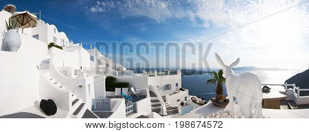 Panoramic view of Santorini, Greece. Traditional Greek architecture, white houses, the Aegean Sea, the caldera.