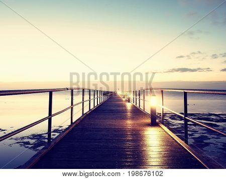 Foot Bridge. Sea Bridge. Outstanding Jetty Construct Goes Towards Open Water