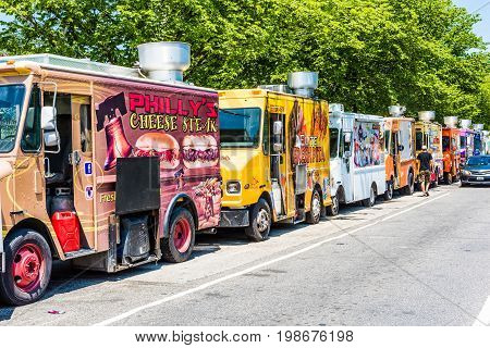 Washington DC USA - July 3 2017: Food trucks on street by National Mall with cars driving by on Independence Avenue