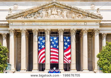 Washington DC USA - July 3 2017: National Archives building on national mall closeup with sign and flag