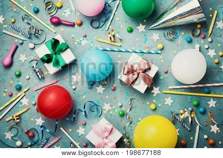 Birthday party background with colorful balloon gift confetti cap star candy and streamer. Flat lay style. Festive greeting card.