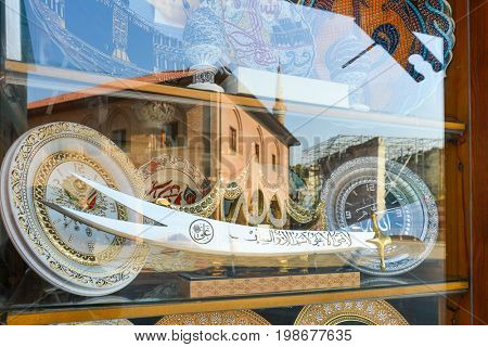 ANKARA, TURKEY - 17 JULY 2017: A shop window reflection of Haci Bayram Mosque. It is one of the best-known mosques in Ankara. It was built during the Ottoman Empire era.