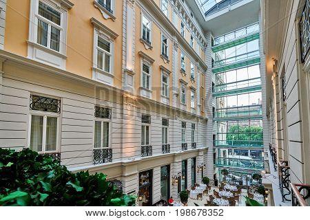 BUDAPEST HUNGARY - JUNE 3 2017: Interior grand atrium inside Corinthia Hotel Budapest known as