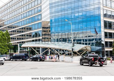 Washington DC USA - July 3 2017: L'Enfant Plaza modern glass metro station entrance by street
