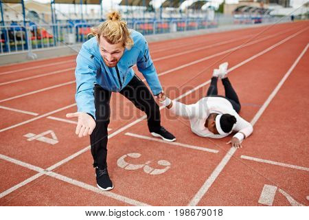Dragging female towards finishing line