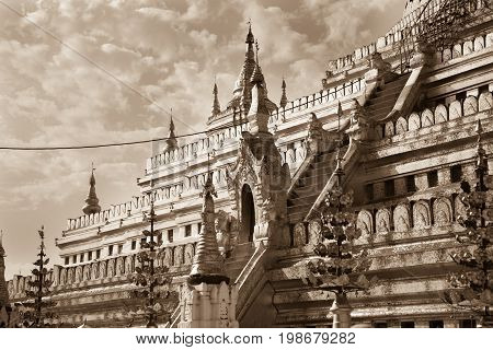 The bottom platform of the buddhist Shwezigon Pagoda in the town of Nyaung-U near Bagan in central Burma - sepia