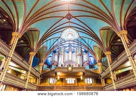 Montreal Canada - May 28 2017: Inside Notre Dame Basilica during mass with organ musical instrument and person playing