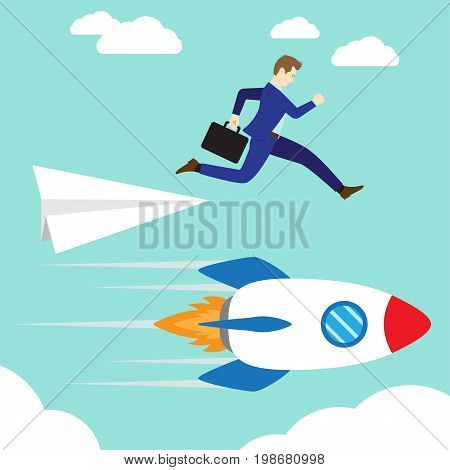 Business Concept As A Businessman Is Jumping Down From A Paper Rocket To A Rushing Real Rocket. It Means Changing From Fragile/Weak/Unreliable Method Way Standard To The Sturdy/Stable/Strong One.